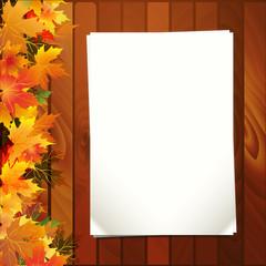 Осенний фон с листочками бумаги и цветными листьями