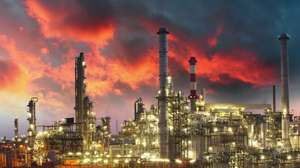 Oil refinery at sunset - time lapse