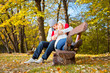 Young romantic couple on a bench in park.
