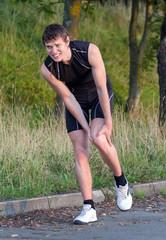 Sportsman holding his leg. Sports injury concept.