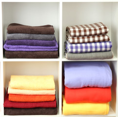 Bright towels and plaids on shelves, isolated on white