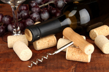 Wine and corks on wooden table