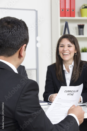 man explaining about her profile to business managers at a job i