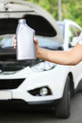 Motor oil in hand