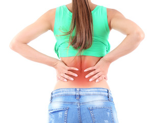 Back pain in young girls isolated on white