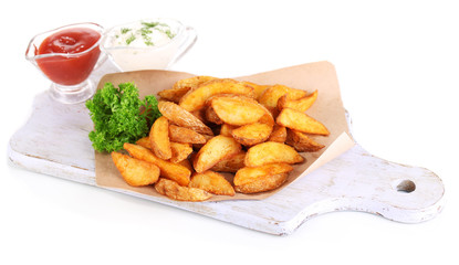 Home potatoes on tracing paper on wooden board isolated on
