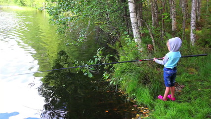 fishing littlle girl with rod on forest lake