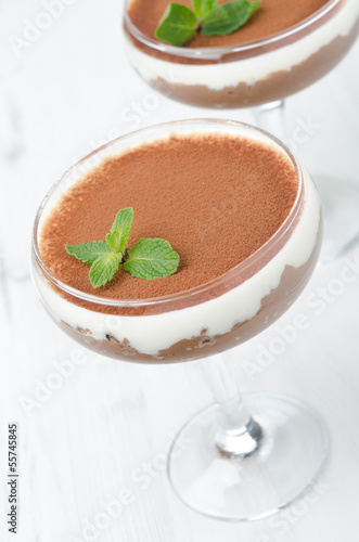 chocolate dessert with whipped cream with mint