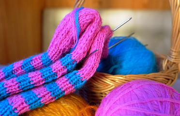 Woollen balls, knitting needles and half-ready sock