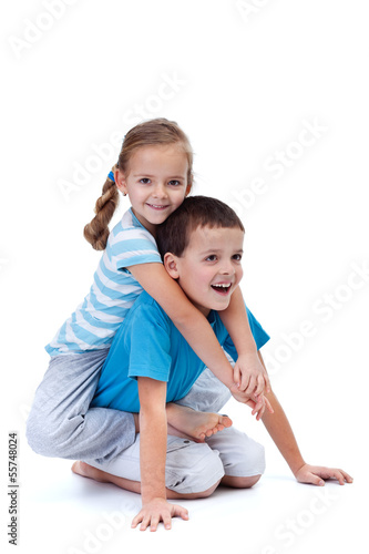Happy kids playing and wrestling on the floor