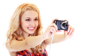 Happy young woman photographer doing photos with still camera