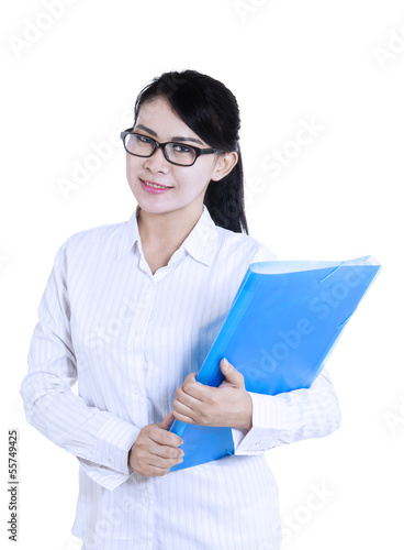 Attractive female doctor holding folder