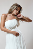 young sexy woman in white trendy dress
