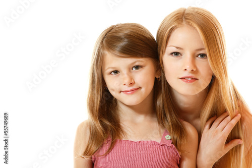 portrait of two happy sisters, teen and child