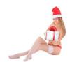Beautiful nude santa woman with gift