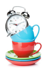 Coffee cups and alarm clock