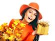 Woman holding  orange handbag.