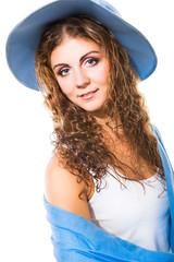 beautiful girl in blue hat and shawl on isolated white