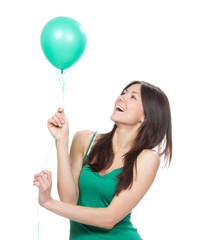 happy girl with green balloon as a present for birthday party