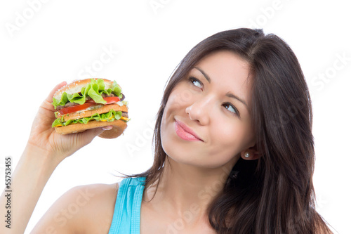 woman with tasty fast food unhealthy burger in hand to eat