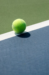 Image of a Tennis Ball on the line