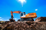 Industrial heavy duty excavator moving earth and soil