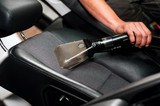 Auto car service cleaning the drivers seat, clealing and vacuumi