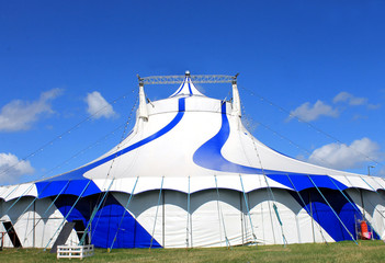 Blue circus tent in green field