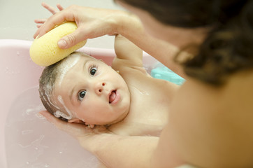 Black eyed baby in bathtub