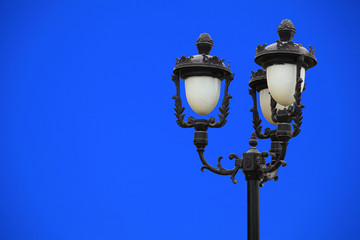 Closeup of street light against blue sky