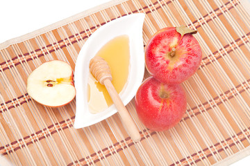 Apple half and saucer of honey