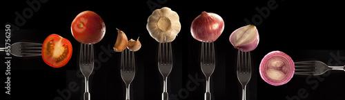 Papiers peints Cuisine variety of foods presented on forks