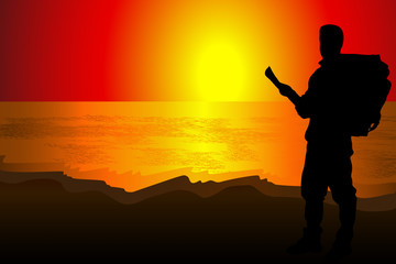 Silhouette of a man of backpacker tourists on an observat