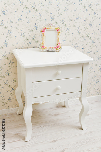 A white dressing table, glass mirror