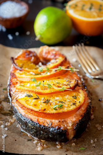 Grilled salmon steak with orange, lime and thyme