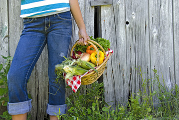 girl with garden vegetables in a basket