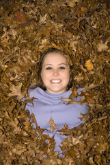 Raking Leaves Tean Girl Laying in Leaf Pile