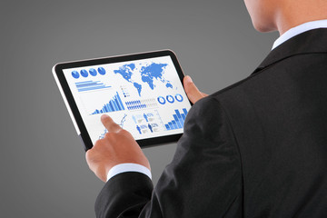 man pushing on a touch screen tablet of infographics