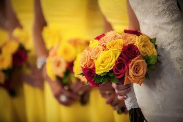 Bride Holding Bouquet with Bridesmaids in Background