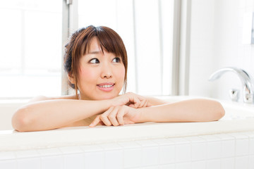 beautiful asian woman relaxing in the bath room