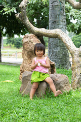 Portrait of funny little Asian girl