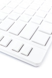 Closeup of a computer keyboard with blank keys. White keyboard i