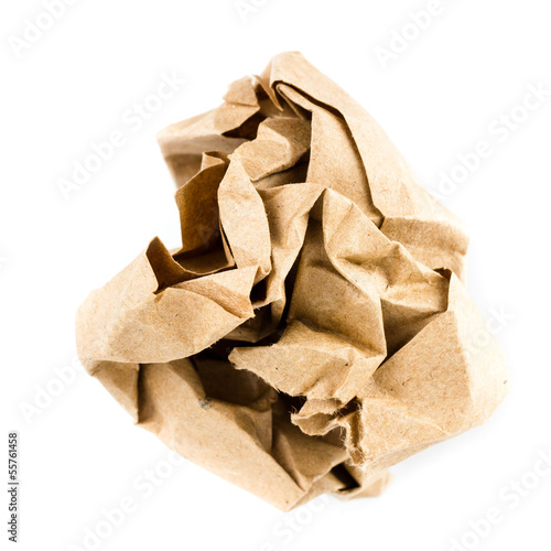 Crumpled recycled paper ball isolated on white background closeu