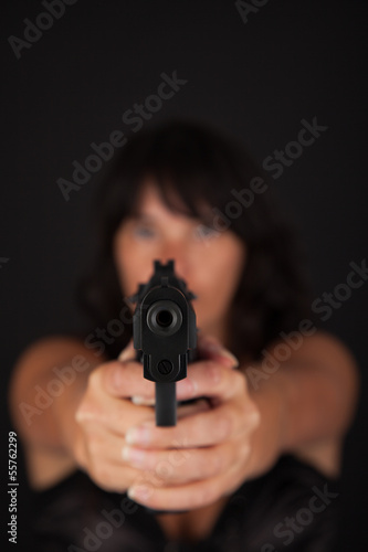 Woman aiming a gun