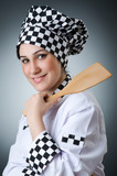 Pretty cook with kitchen utensils