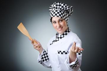 Pretty cook with kitchen utensils