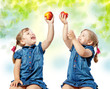 portrait of twin girls eat fruit, abstract background