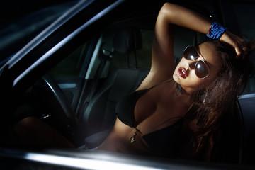 Sexy lady posing in a sport car.