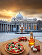 Basilica on St. Peter square with pizza in Vatican, Rome