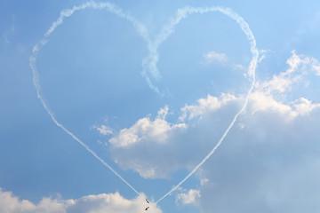 Aircrafts paint big heart of smoke at air